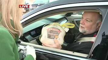 Capt. Ken Chapman, of the Salvation Army, donates a turkey.