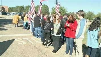 More than 1,700 NWRHS students lined up with flags and signs to welcome Armstrong home.