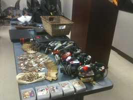 Jackson police say they've arrested six people accused of having ties to stolen guns, coins and even a sword.