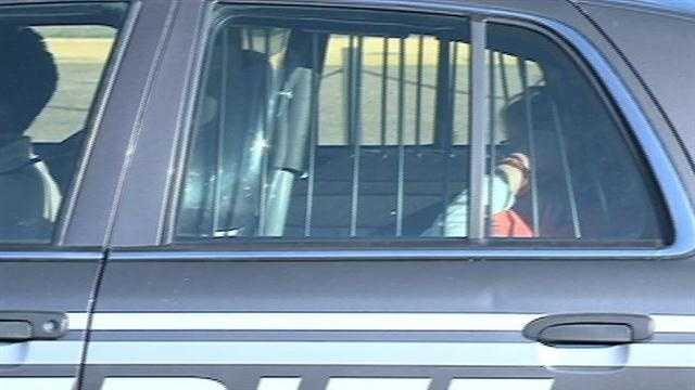 Linda Reed in cop car