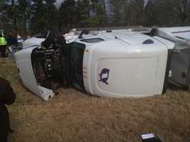 Authorities say the driver of the truck lost control, drove into the median and flipped the semi on its side.