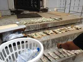 Officers also seized nearly $13,000 in cash.