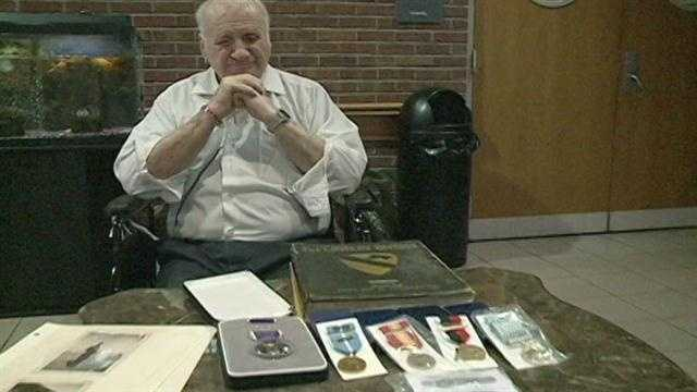 Owen Girley and his six medals, including the Purple Heart and Combat Infantry Badge.