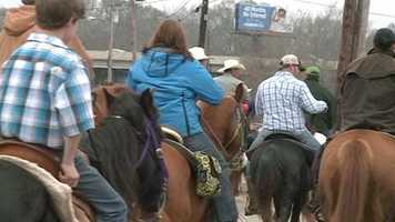 The Dixie National Rodeo rolled into Jackson Thursday with a wagon train.