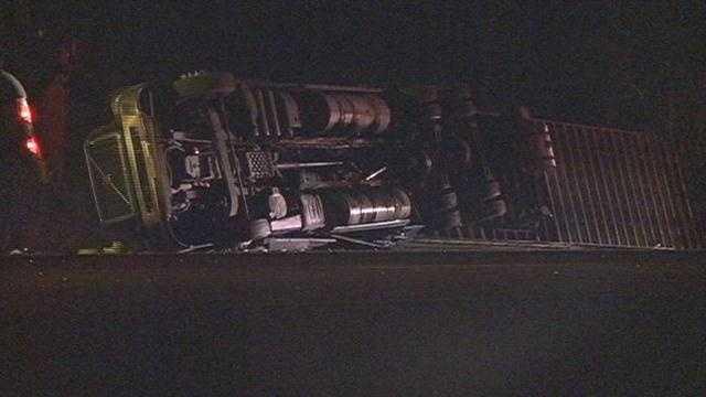 18-wheeler overturns off of I-20