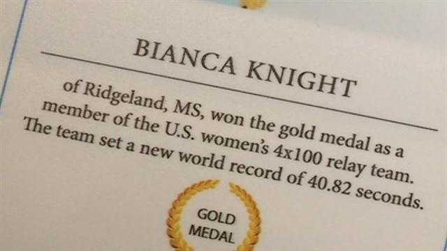 Bianca Knight give golden gifts to sports museum