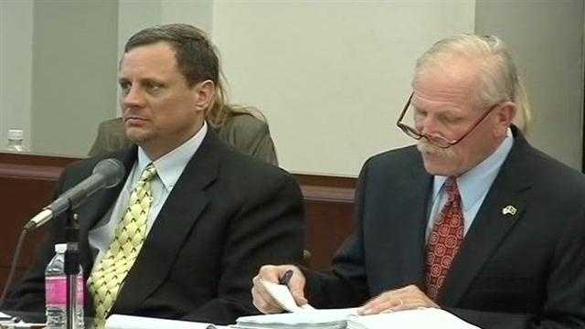 Richard McGahey, left, listens to testimony.
