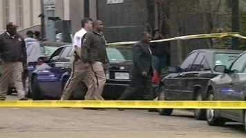 Hinds County Sheriff Tyrone Lewis, right, arrives at the scene.