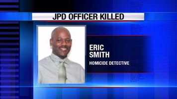 Decorated homicide Detective Eric Smith was gunned down inside an interview room late Thursday afternoon as he was questioning 23-year-old murder suspect Jeremy Powell about a killing days earlier.