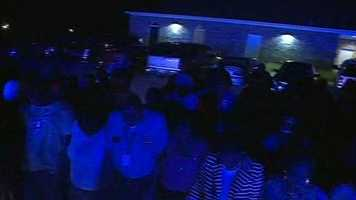 After the service, police blue lights flickered as the crowd remembered Smith in prayer.