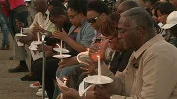 """""""You don't really think how much someone is really loved, and it just really shows how much he touched so many people in the community,"""" Smith's daughter, Jamillah Henson, said about the number of people who attended Sunday night's candlelight vigil."""