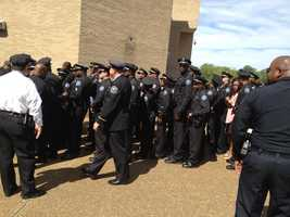 Thousands of officers, friends and family members attend a funeral at JSU's basketball arena for slain JPD Detective Eric Smith.