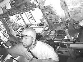 Jackson police release these surveillance images of a man wanted in connection with a business burglary.