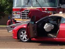 A Jackson fire truck and a red convertible collide on Lakeland Drive.