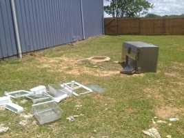 The burglars tried to steal a refrigerator, but left it outside.