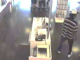 The Jackson Police Department is looking for two men officers say are shown on surveillance video robbing a T-Mobile store at gunpoint.