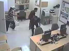 The robbers forced employees to lay face down in the back of the store, police say.