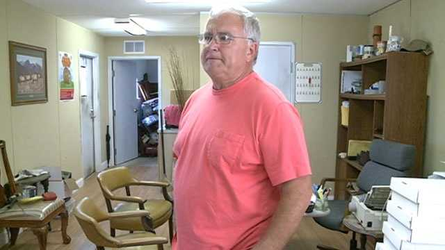 Victor Dorman spent Wednesday morning cleaning up his auto sales office after it was trashed by thieves.