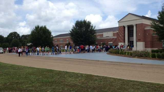 Clinton students in line for macBooks