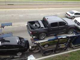 Police said the load was too high and hit a bridge, knocking the Xterra off the truck.