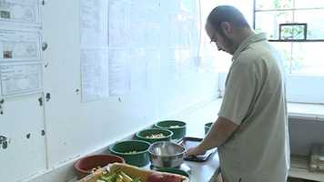 A zoo employee prepares food for the animals.