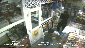 He opens fire on the clerk as he runs away.