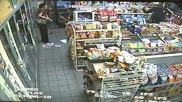 The first store clerk speaks to police after the shooting and robbery.