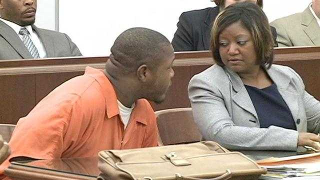 Adrian Montgomery speaks with his attorney.
