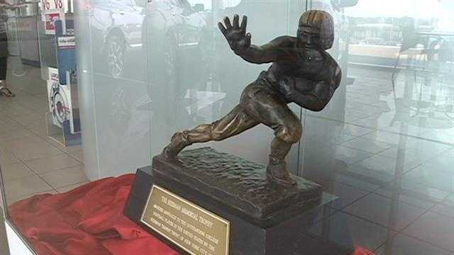 Hiesman Trophy on display inside Jackson car dealership