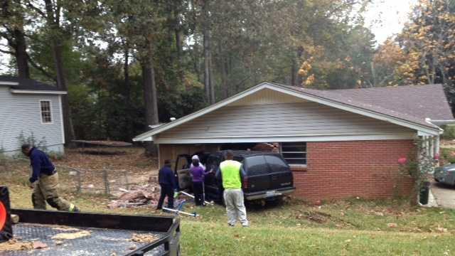 SUV into house