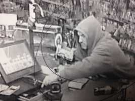 Police say the robber threatened the store clerk with a butcher knife before reaching into the cash register.