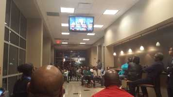 An overflow crowd watched the debate outside the event.