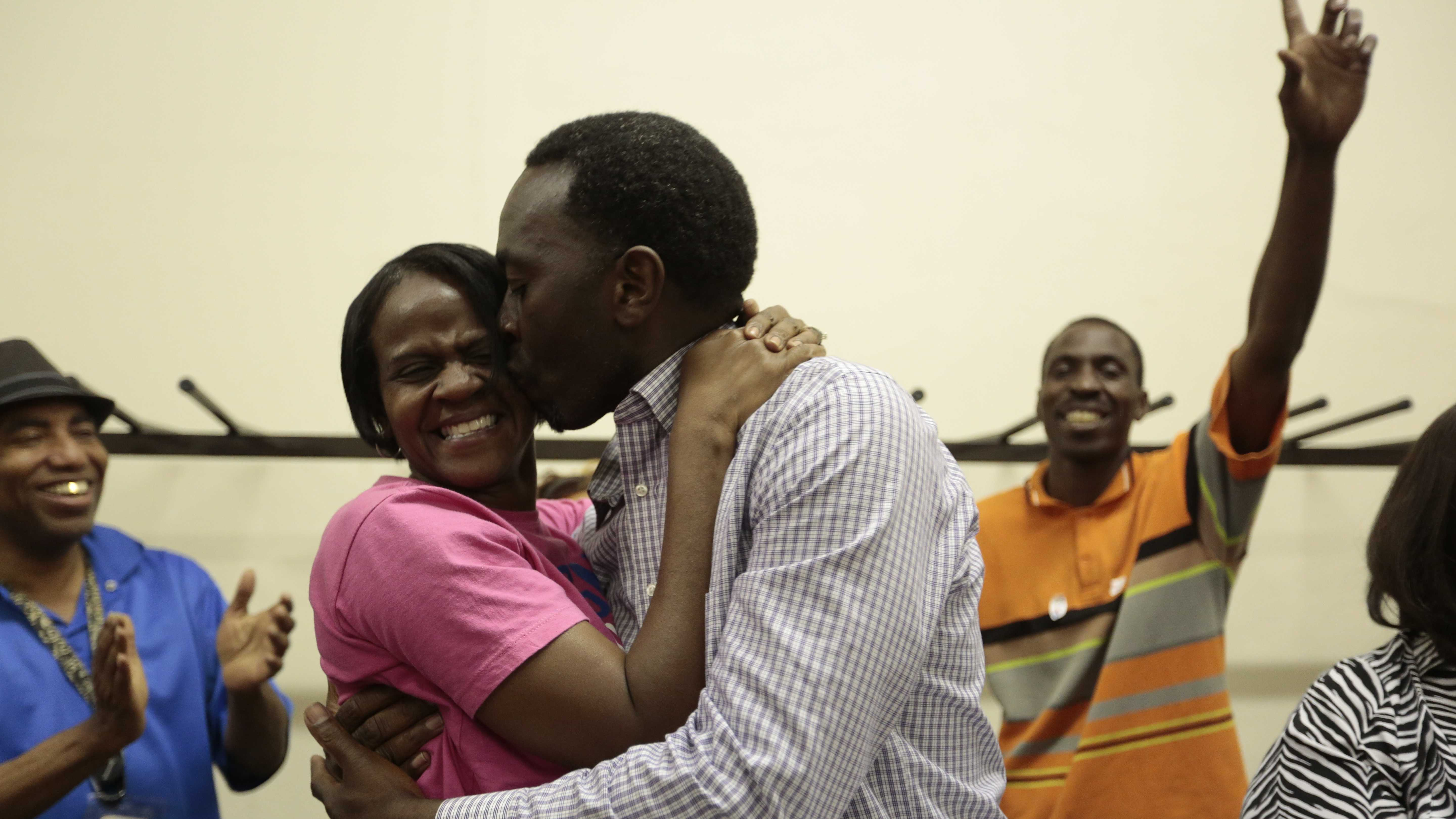 Anthony Witherspoon kisses his wife Tammy after being declared the winner of Tuesday's special mayoral election in Magnolia.