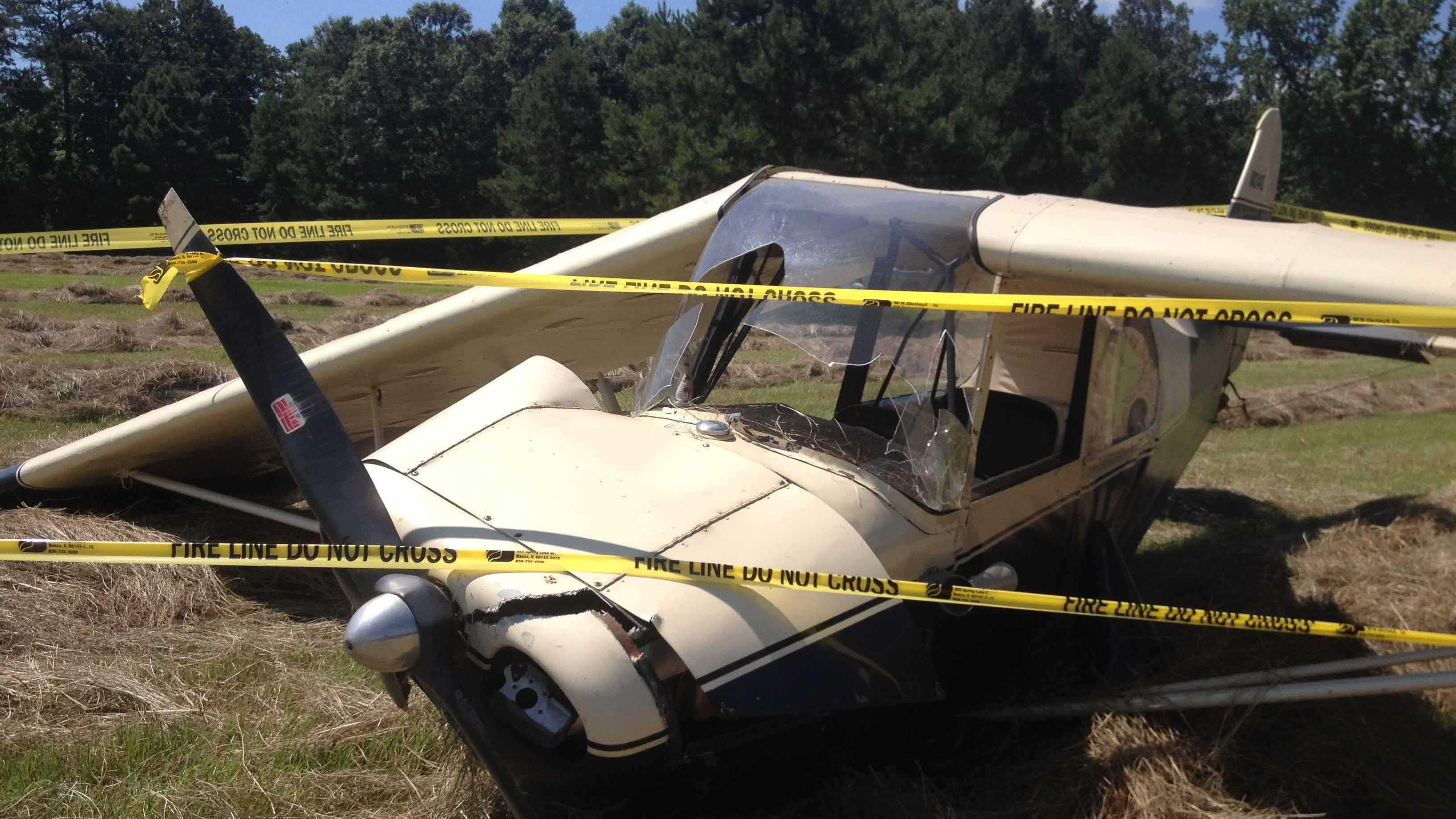 Three people survived a plane crash following an emergency landing in a Prentiss hay field.
