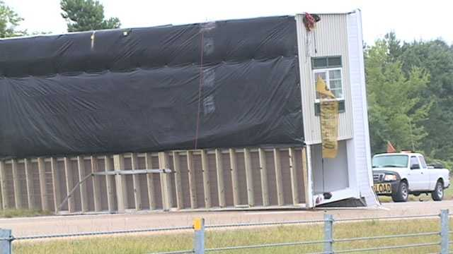 Mobile home flips onto interstate