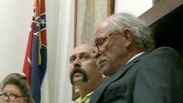 Bruce Barlow, center, during a meeting at City Hall in early October.