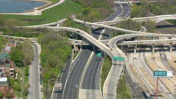 SkyTeam 11 flies over the Jones Falls Expressway in Baltimore City.