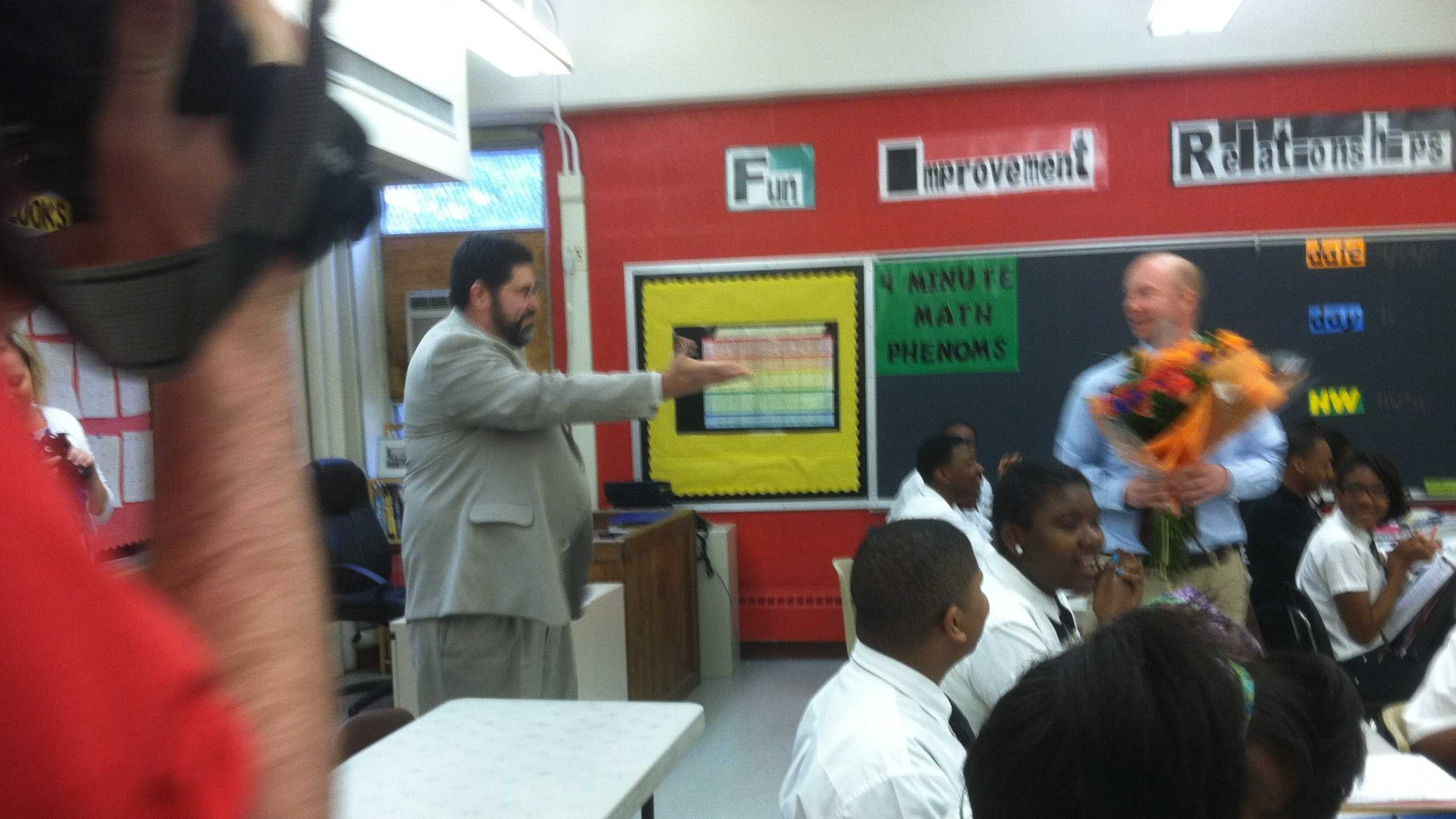 A Baltimore City charter school teacher gets a big surprise as he is honored with the district's Teacher of the Year award.