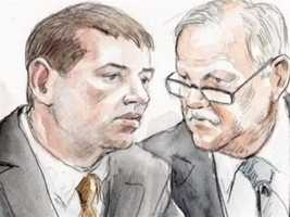 George Huguely consults with defense attorney Francis Lawrence