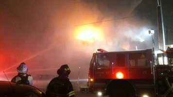 Baltimore firefighters evacuate homes in the Canton area Sunday night as a multiple-alarm warehouse fire billowed heavily flames.
