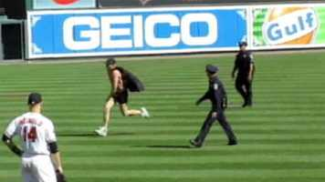 Don't do this: Mark Harvey dons a cap and Batman underwear on Opening Day, making a run for it. Thank him and others like him for the increased security.