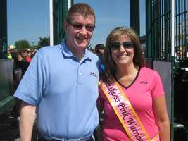 Maryland Jockey Club president Tom Chuckas and Ms. Preakness Pink Warrior Kathleen Kelly wish the runners the best of luck. Part of the proceeds from the race benefits the Maryland Affiliate of Susan G. Komen for the Cure