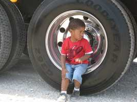 Like Logan, (pictured), kids explored every inch of the largest vehicles in the city's fleet.