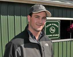 Tyler Cerin, 24, is an equine physical therapist is responsible for identifying and treating muscular issues that might develop with Reddam Racing's Kentucky Derby-winning I'll Have Another. (Full Story) | Jim McCue\Maryland Jockey Club
