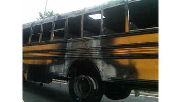 WASHINGTON (AP) - Authorities say a school bus ignited Monday morning while being towed in the 3rd Street Tunnel in southwest Washington.