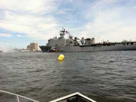 As it makes its way through Baltimore Harbor with Fort McHenry off its port side.