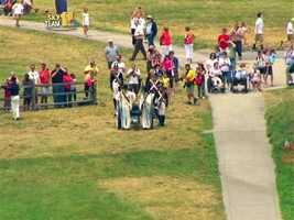A sea of people waived goodbye from Fort McHenry.