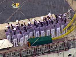 Mexican sailors stood at attention from the top of the sails all the way down to the deck, and on the deck, the sailors waved farewell.