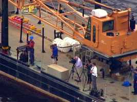 That's 11 NewsphotographerMac Finney third from the right, capturing the ships' departures for 11 News.