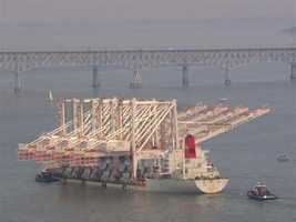 The cranes can reach 22 containers across on a container ship, and lift 187,300 pounds of cargo.